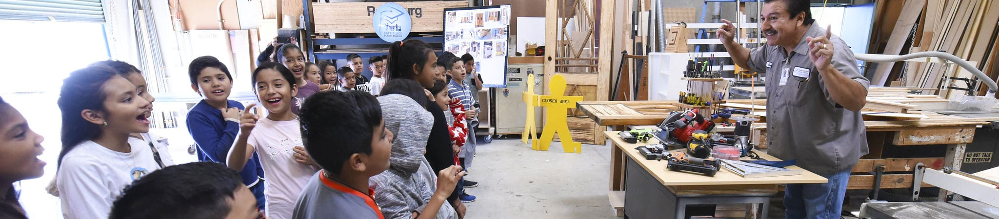 A Maintenance & Operations employee shows a group of students part of the Maintenance & Operations building.